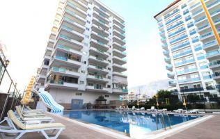 В современной резиденции продается меблированная двухкомнатная квартира, р. Махмутлар, Аланья.