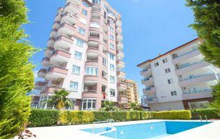 Продажа квартиры с двумя спальнями в жилом комплексе с бассейном, р. Аланья, Махмутлар