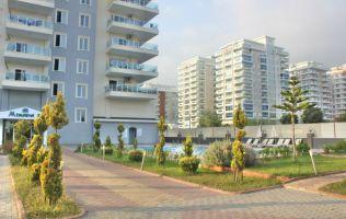 Новая квартира 1+1 в Алании р.Махмутлар, с одной спальней и рядом с морем.