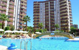 просторная квартира в Аланье с красивым видом на сад и бассейн по доступной цене