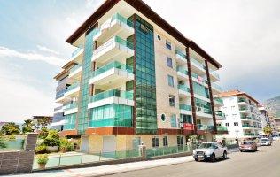 Новые меблированные апартаменты 4+1 в Алании, первая береговая линия, Кестель