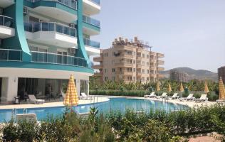 Новая квартира в Алании с видом на горы по выгодной цене, район Махмутлар.