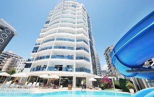 Новая квартира 1+1 в современной резиденции в центре Махмутлара/Аланья