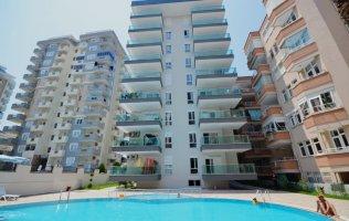 Новая двухкомнатная квартира в Алании, р-н Махмутлар