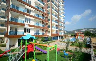 Новая квартира с видом на море в Махмутларе, в комплексе повышенной комфортности