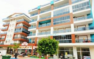 Новые апартаменты с мебелью в Аланье, р-н пляжа Клеопатры