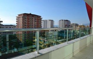 Апартаменты 1+1 с прекрасным видом на море и город, Махмутлар