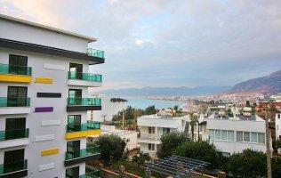 Новые апартаменты 1+1 с видом на море в Каргыджаке, Аланья