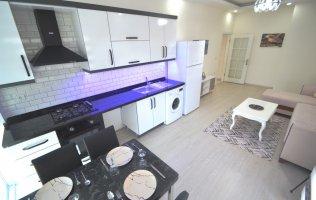 Новая меблированная 2+1 квартира в популярном районе Махмутлар