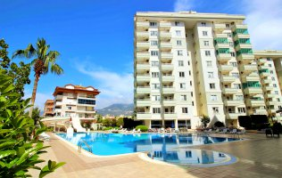 Новые апартаменты 2+1 всего в 150 метрах от моря в Тосмуре, Аланья