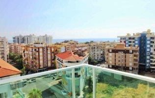 Просторные апартаменты в Алании с видом на море р.Тосмур.