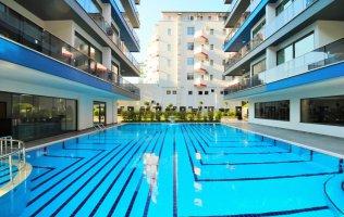 Новая квартира в Алании на первой береговой линии от моря район Махмутлар