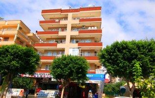 Просторная квартира в Алании по доступной цене в 100 метрах от моря.