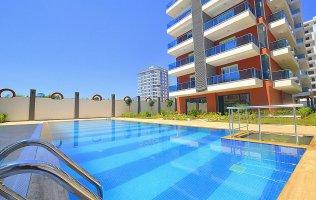 Новые апартаменты в Алании в комплексе с инфраструктурой